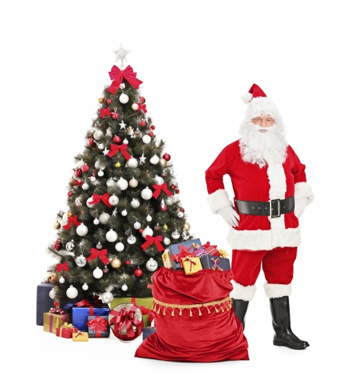 Santa standing next to a christmas tree